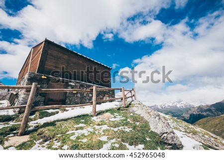 Typical Hut in the italian Alps - stock photo