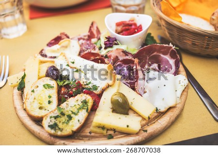 Typical italian antipasto with ham, cheese, olives - stock photo