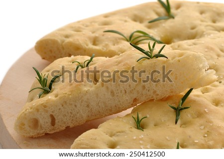 Typical italian Bread slices with rosemary in white isolated background - stock photo