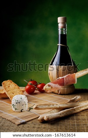 typical Italian snack with cheese and red wine