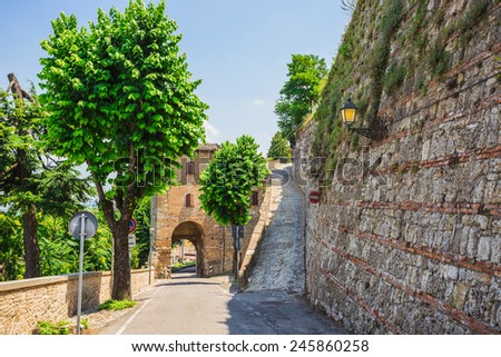 typical Italian street in a small provincial town of Tuscan, Italy, Europe - stock photo