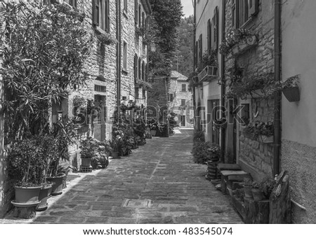 typical Italian street in a small provincial town of Tuscan, Italy, Europe  . Black and white photography.
