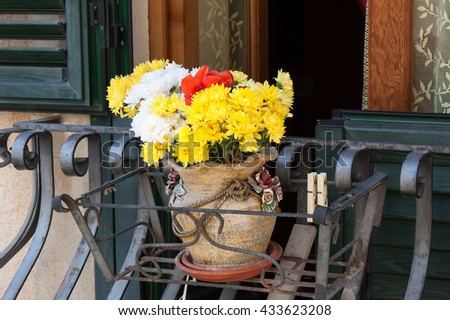 typical italian window with fresh Flowers
