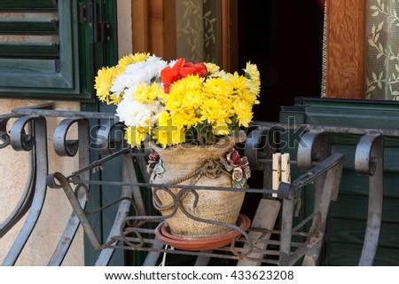 typical italian window with fresh Flowers - stock photo