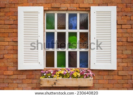 Typical Italian Window With Open Wooden Shutters, Decorated With Fresh Flowers - stock photo