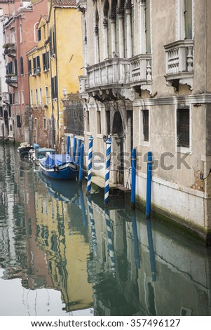 typical little venetian romantic canal in the mist, Venice, Italy