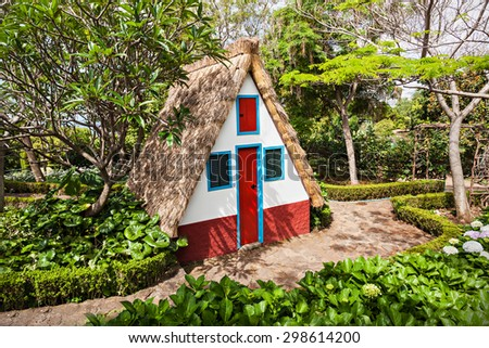 Typical local house in Santana village, Madeira island, Portugal - stock photo