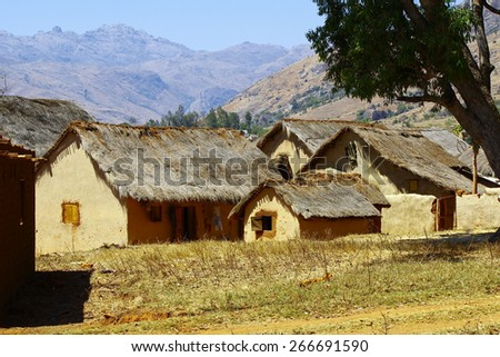 Typical malgasy village - african hut, poverty in madagascar - stock photo