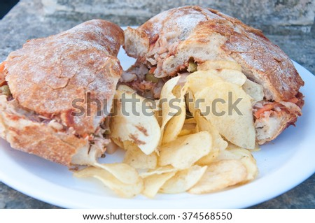 Typical Maltese bread called ftira accompanied by french fries,malta - stock photo