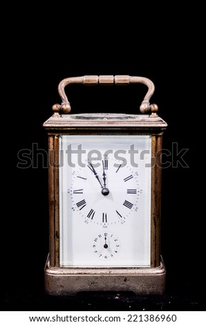 Typical Mechanical Alarm Clock Isolated on a Black Background
