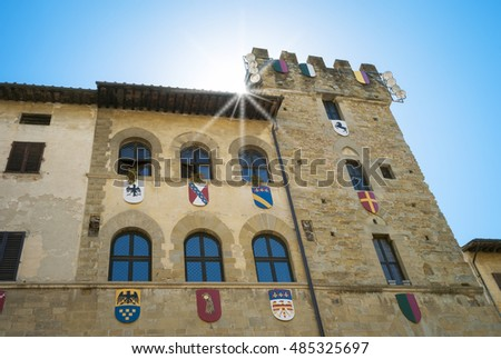 Typical medieval palace facade in Arezzo (Italy, Tuscany), decorated with the signs of the city districts used during the medieval historical reenactment known as Giostra del Saracino. Color image.