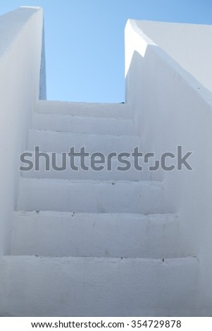 Typical mediterranean staircase found in southern European countries. Location: Olhao, Algarve, Portugal. - stock photo