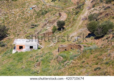 Typical mountain agricultural estate near Karystos in Greece - stock photo
