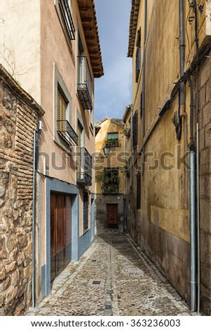 Typical narrow alley in the old town of Toledo