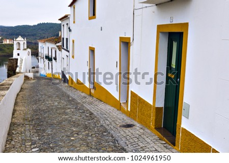 Typical narrow street in the ancient town of Mertola, Alentejo Region, Portugal.