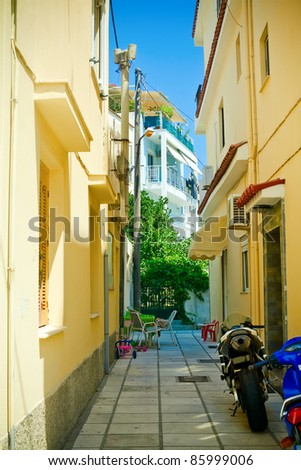 typical narrow street somewhere in Kos Island, Greece - stock photo