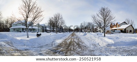 Typical neighborhood after six inches of snow fell overnight.  - stock photo