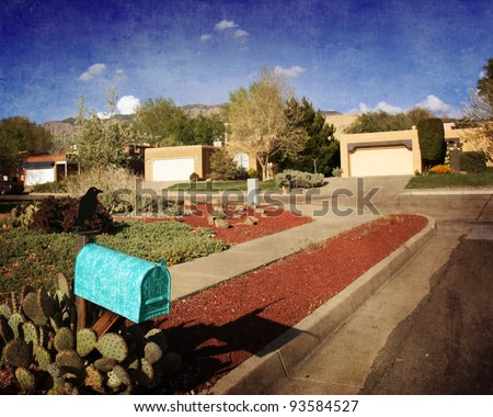 Typical neighborhood in Albuquerque, New Mexico with a quaint turquoise mailbox - stock photo