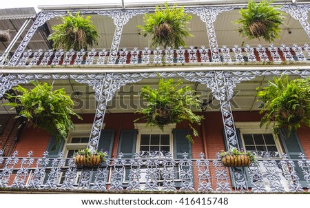 Typical New Orleans mansions with iron balcony - NEW ORLEANS, LOUISIANA - APRIL 18, 2016  - stock photo