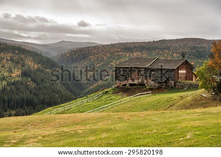Typical norwegian farmhouse shed in autumn near Rondane National Park, Norway - stock photo