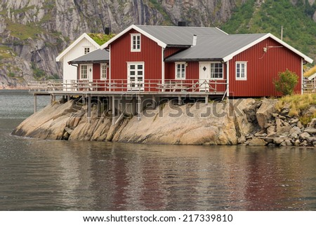 Typical norwegian fishing village with traditional huts, Lofoten islands, Norway - stock photo