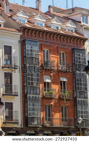 Typical old balconies enclosed with wood and glass - stock photo
