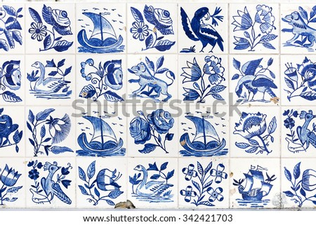 Typical old blue azulejos on the public building exterior in Alfama district, Lisbon, Portugal.