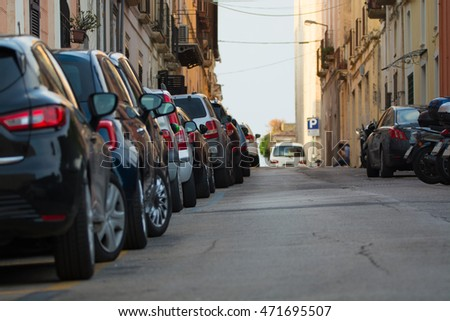 Typical old city street. Cars parked along the street in Gaeta, Italy