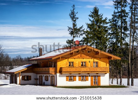 typical old fashioned farmhouse in bavaria - stock photo