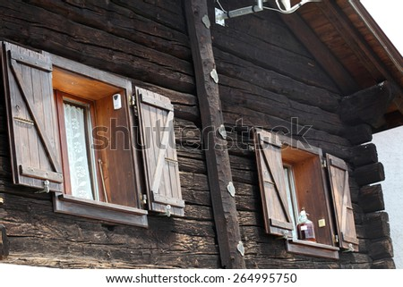 Typical old wooden village house in Swiss Alps - stock photo