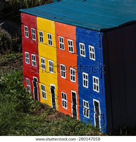 Typical painted woodbox in rural Newfoundland, Canada. - stock photo