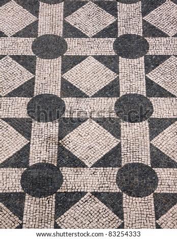 "Typical Portuguese black and white stone mosaic ""calcada""  pavement - Cascais Lisbon Portugal - stock photo"