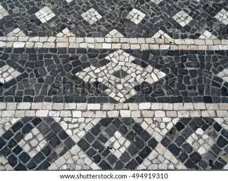 "Typical Portuguese black and white stone mosaic ""calcada"" pavement - found throughout Portugal"
