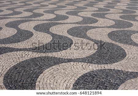 Typical Portuguese black and white stone mosaic calcada pavement - found throughout Portugal - Cascais, Lisbon, Guimaraes. Also in Rio de Janeiro, Brazil.