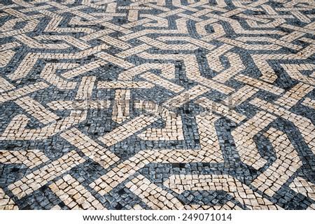 Typical portuguese cobblestone hand-made pavement in Portugal, Lisbon.  - stock photo
