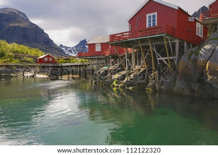 Typical red fishing huts Rorbu on Lofoten islands in Norway - stock photo