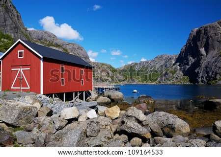 Typical red shed on the coast of fjord on Lofoten islands in Norway