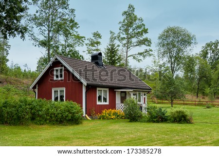 Typical red wooden cottage in the countryside near Hoegsby, Sweden - stock photo