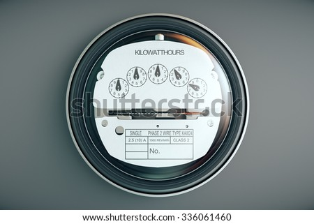 Typical residential analog electric meter with transparent plactic case showing household consumption in kilowatt hours. Electric power usage.