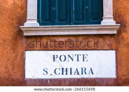 Typical road sign in venice street, Italy - stock photo