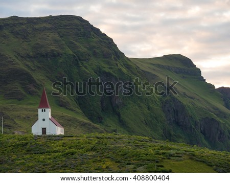Typical Rural Icelandic Church in a beautiful landscape. - stock photo