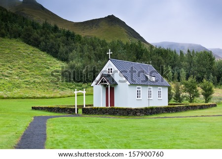 Typical Rural Icelandic church in siding house at overcast day - stock photo