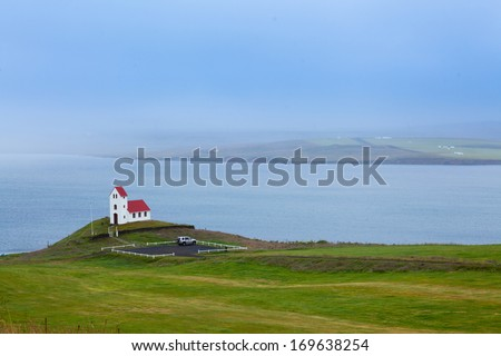 Typical Rural Icelandic Church under a blue summer sky. Horizontal shot - stock photo