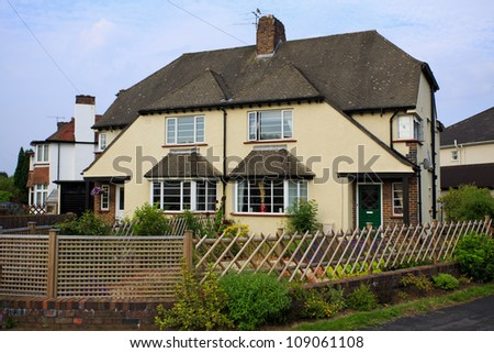 Typical 1930s cream colored semi detached house with Bay Window, in Bristol, England - stock photo
