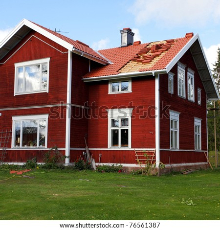 Typical scandinavian  red wooden cottage - stock photo