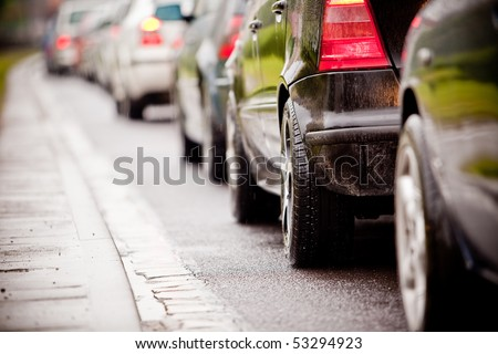 Typical scene during rush hour. A traffic jam with rows of cars. Shallow depth of field.