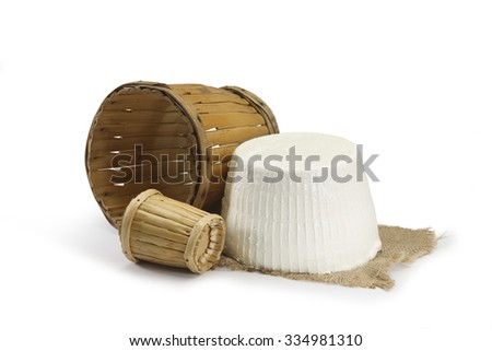 Typical Sicilian Ricotta cheese with container cane - stock photo