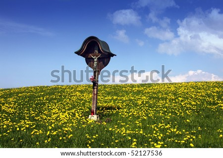 Typical Slovenian statue of Jesus Christ on a cross - stock photo