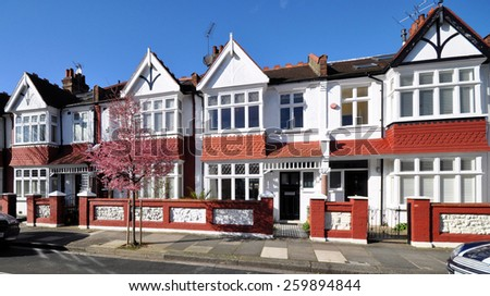 Typical small Edwardian period terraced houses built in 1913 in west London, UK. - stock photo