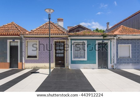 Typical small houses decorated with traditional tiles in the city of Aveiro, Portugal. - stock photo